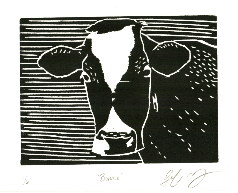 A black and white print of a cow